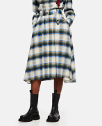 Tartan skirt with brooches