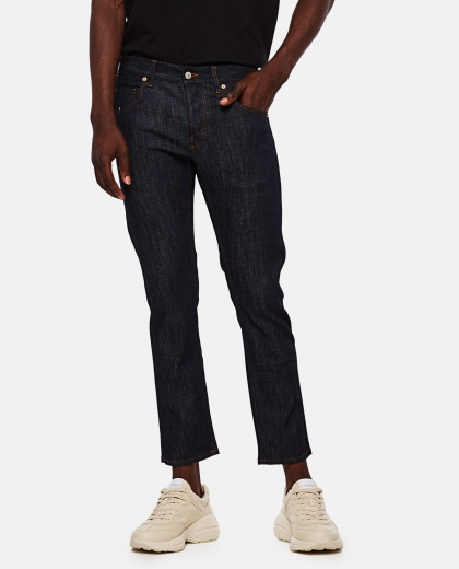 Skinny jeans with délavé effect Men Gucci 000267770039501 1